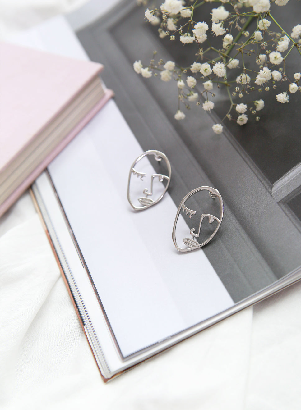 LIV Face Earrings (Silver) at $ 19.50 only sold at And Well Dressed Online Fashion Store Singapore
