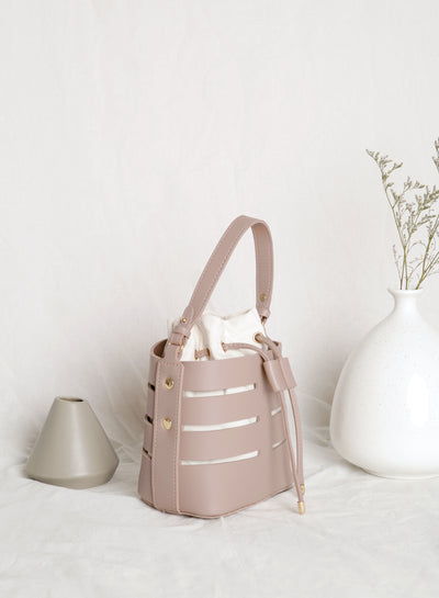 Frances Cutout Bucket Bag (Mauve) at $ 31.50 only sold at And Well Dressed Online Fashion Store Singapore