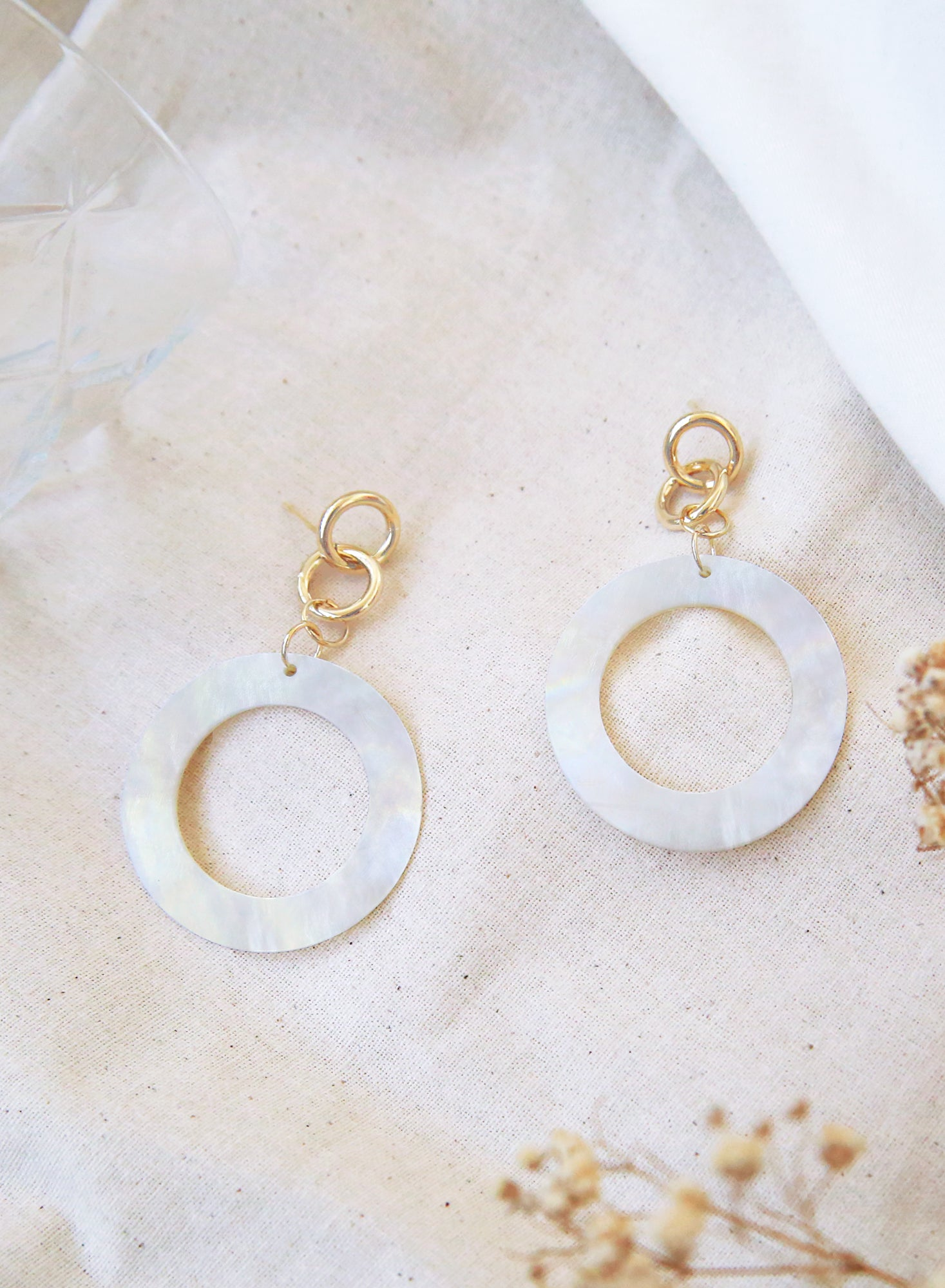 Mother of Pearl Hoop Earrings at $ 28.00 only sold at And Well Dressed Online Fashion Store Singapore