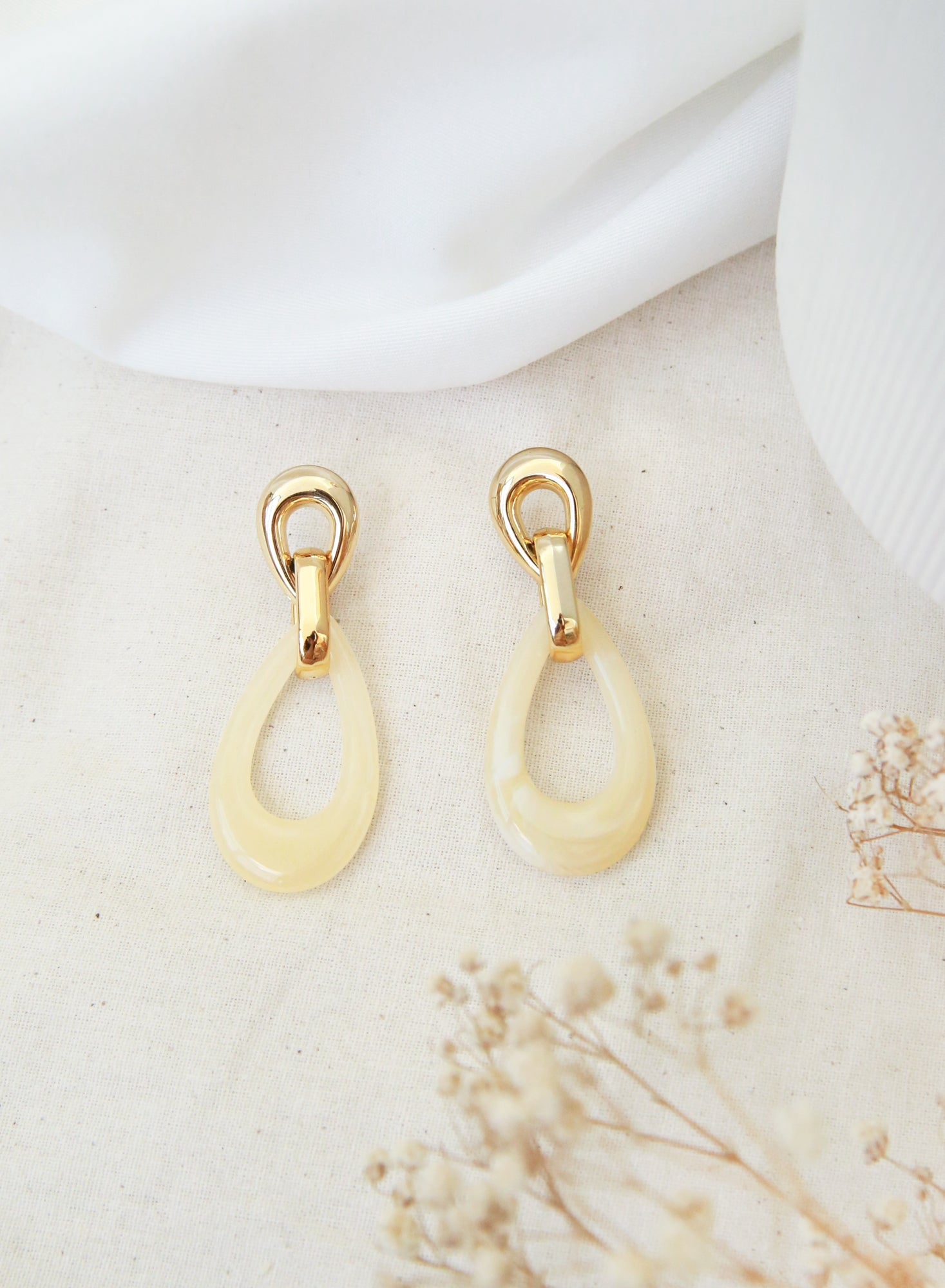 Ivory Stone Resin Gold Earrings at $ 24.00 only sold at And Well Dressed Online Fashion Store Singapore