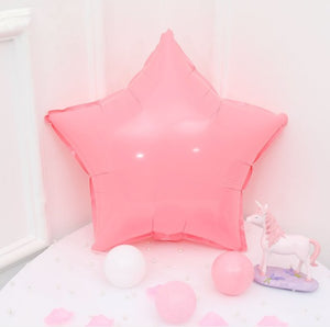pink macaroon colored star shaped balloon