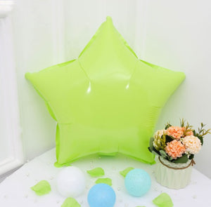 lime green macaroon colored star shaped balloon
