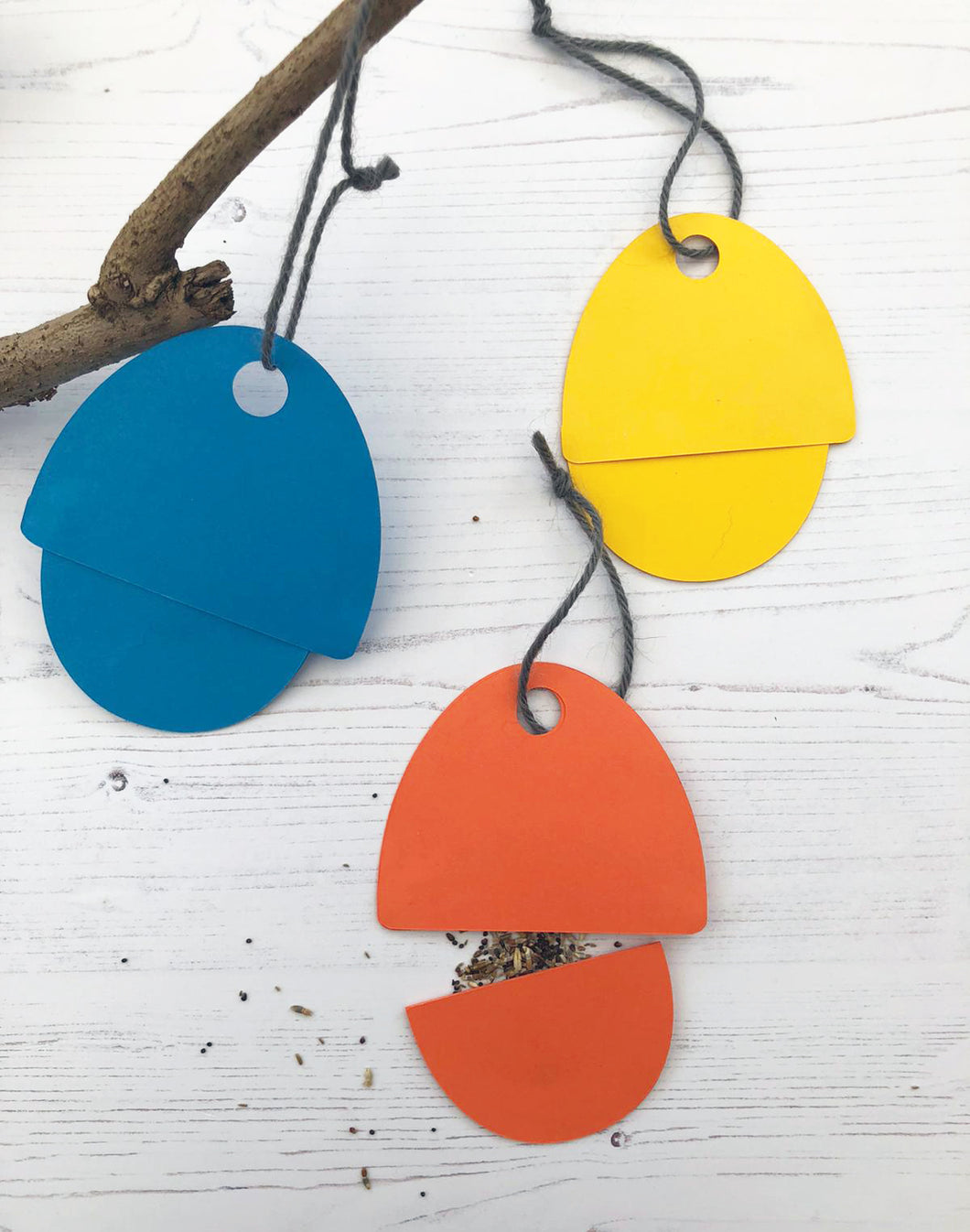 Three Egg shaped hanging 'envelopes'