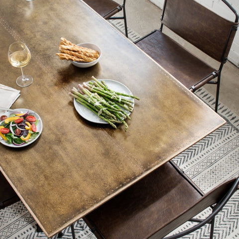 Skylar Dining Table Brass top with iron black base