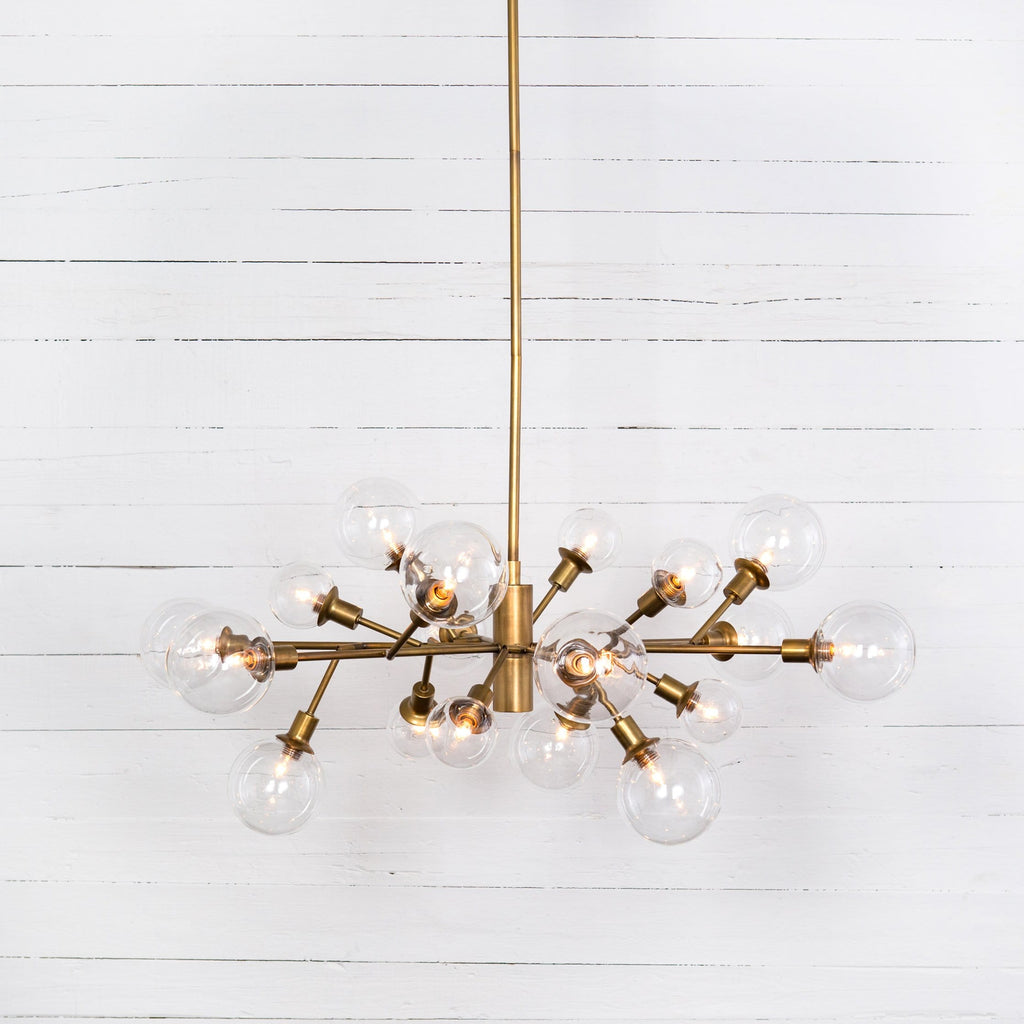 penelope chandelier matte brass sculptural midcentury iron glass