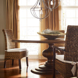 Clancy round farmhouse mango wood dining table dark brown staged