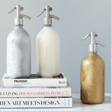seltzer bottles gold silver white frosted