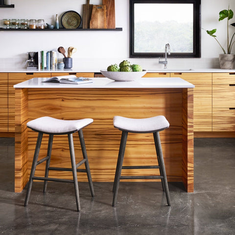 Knoxville Counter + Bar Stool white upholstery saddle seat black oak wood legs modern counter front view