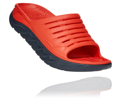 Picture this - You've just finished a long run or grueling race and simply put, your feet need some TLC. Enter the ORA Recovery Slide from Hoka. It features an oversized cushioned midsole and rocker shape into a slide design. You'll love the result. Comfort and support when and where you need them. These are even great for house shoes.