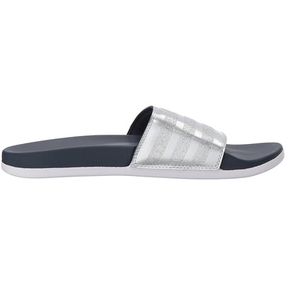 Slip into these Women's adidas Adillete slides for easy-to-wear comfort. A contoured footbed features Cloudfoam Plus for a super-soft cushioned feel.