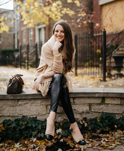 knit sweater with leather trousers and handbag