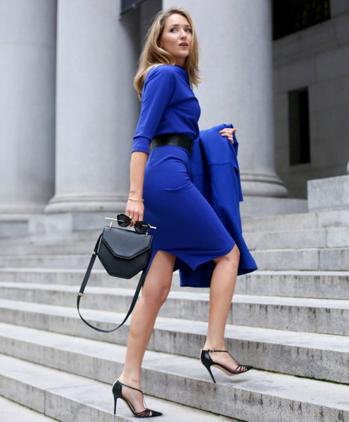 cobalt blue classic outfit with modern structured bag