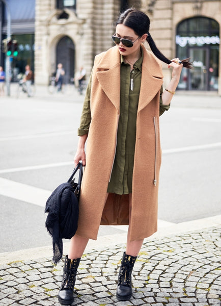 camel coat with olive green shirtdress and edgy boots