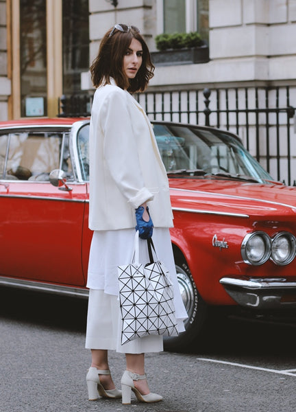 geometric inspired bag with all white outfit