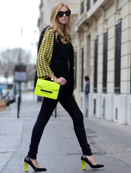 skinny jeans with breezy top and neon yellow bag
