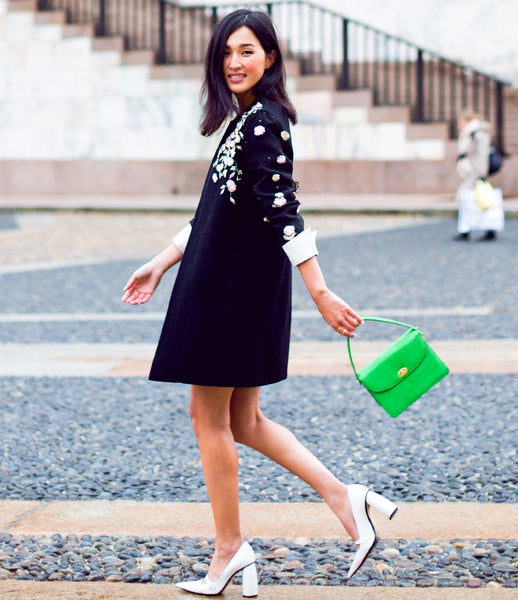 shift dress with green bag and block heeled pumps