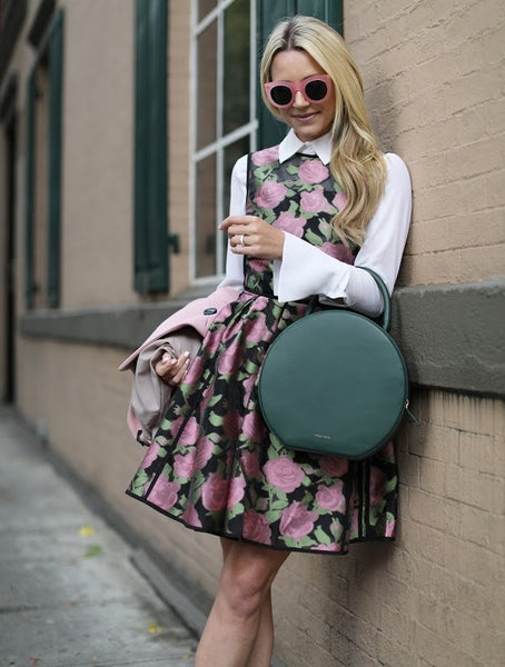 floral print dress with collared top and rounded bag