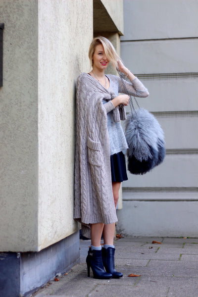 fur bag with knitted cardigan and gray top