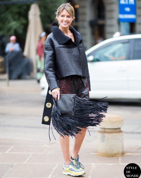 eclectic outfit with fringe clutch and metallic sneakers