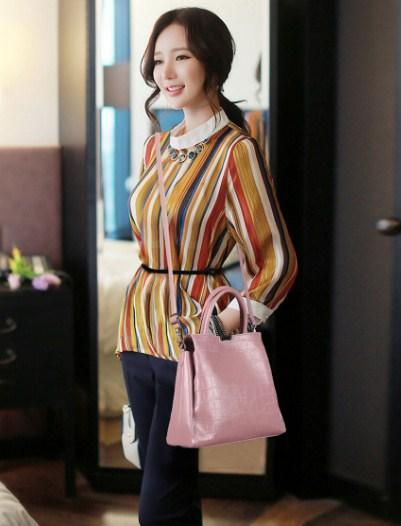 casual stylish woman with pink handbag