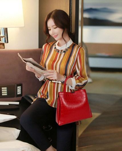 casual stylish woman with red handbag
