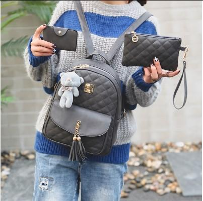 Casual Stylish Woman With Gray Quilted Backpack with Tassel- Front View