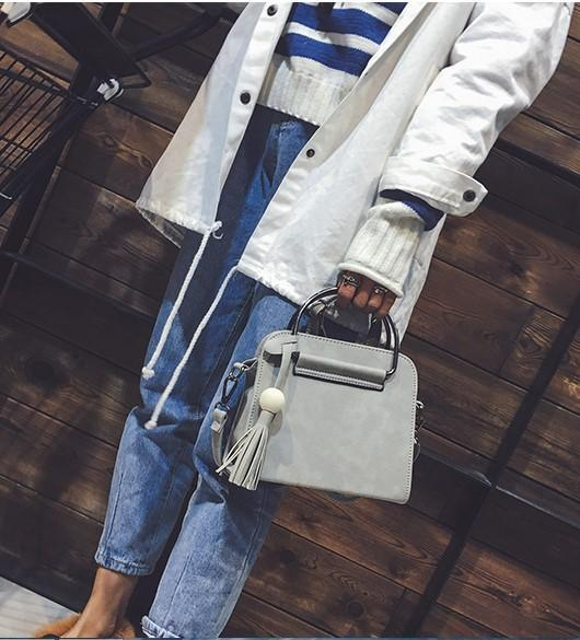 Casual Stylish Woman With Grey Leather Handbag With Tassel-Side View