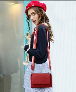 Casual Stylish Woman With Red Suede Messenger Bag with Striped Strap- Front View