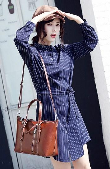 Casual Stylish Woman With Brown Vintage Satchel Bag - Front View