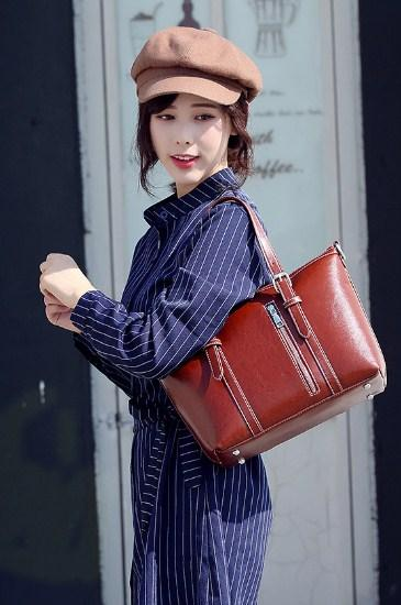 Casual Stylish Woman With Brown Vintage Satchel Bag - Side View