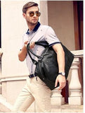 Casual Stylish Man With Black Leather Duffel Bag- Top View