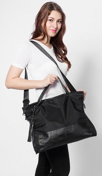 Casual Stylish Woman With Black Satchel Bag - Side View
