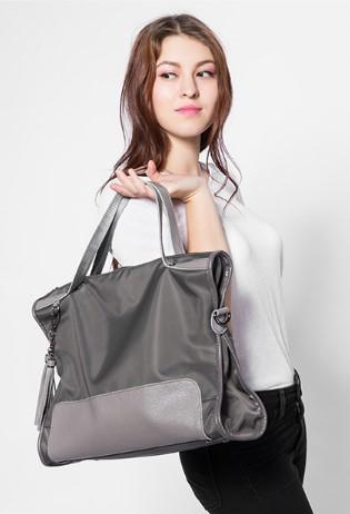 Professional Stylish Woman With Grey Satchel Bag-Side View