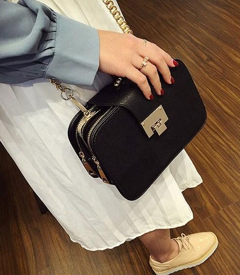 Casual Stylish Woman With Black Clutch with with Metal Buckle - Side View