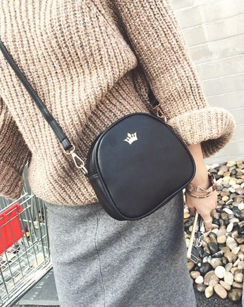 Casual Stylish Woman With Black Mini Bag with Crown-Front View