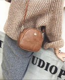 Casual Stylish Woman With Brown Mini Bag with Crown-Side View