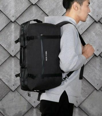 professional stylish man with black Travel Bag - Side view