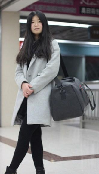 Casual Stylish Woman With Khaki Cool Travel Bag - Side View
