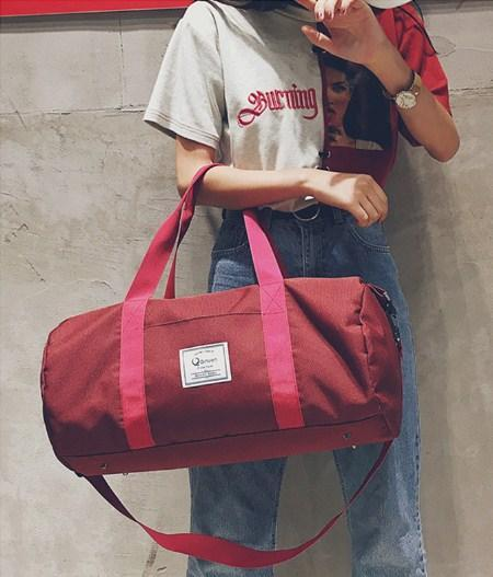 Casual Stylish Woman With Red Inspired Duffel Bag - Front View