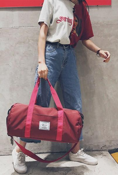 Casual Stylish Woman With Red Inspired Duffel Bag - Side View