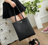 Casual Stylish Woman With Black Classic Tote Bag-Side View
