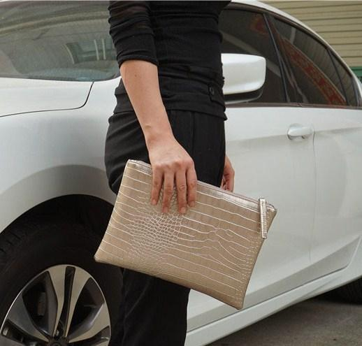 Casual Stylish Woman With Gold Crocodile Patterned Envelope Clutch - Side View