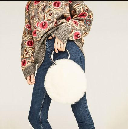 Casual Stylish Woman With White Cute Fur Ring Bag-Side View