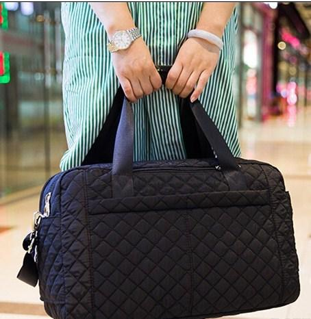 Casual Stylish Woman With Black Quilted Travel Bag - Front View