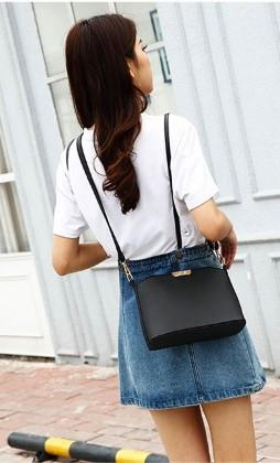 Casual Stylish Woman With Black Messenger Bag- Front View
