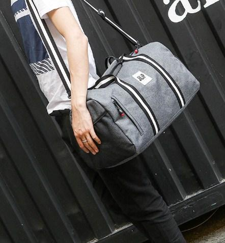 Casual Stylish Man With Gray Preppy Cool Duffel Bag - Side View