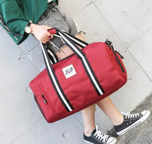 Casual Stylish Man With Red Preppy Cool Duffel Bag - Front View