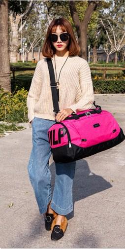 Casual Stylish Woman With Pink Utilitarian Gym Bag - Side View