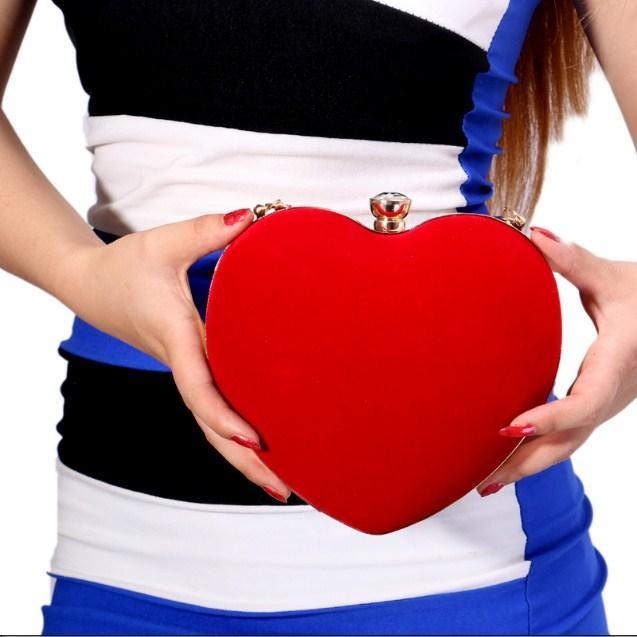 Casual Stylish Woman With Red Heart Shaped Clutch - Front View