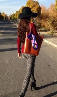 casual stylish woman with brown Leather Tote Bag - Back view